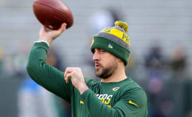 Aaron Rodgers warms up before the Wildcard Game against the Giants.