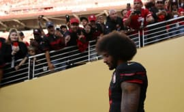Colin Kaepernick takes the field before the 49ers game against the Cardinals.