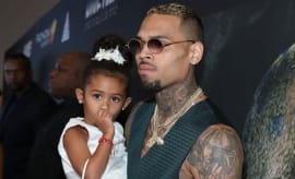 Singer Chris Brown (R) and his daughter Royalty