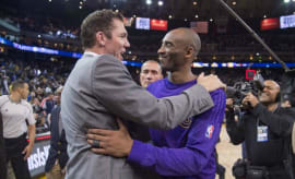 Luke Walton and Kobe Bryant embrace after a game.
