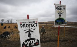 Water protectors protest as police line the hill at Standing Rock on Nov. 24, 2016,