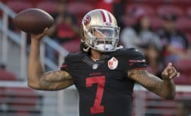 Colin Kaepernick throws a pass during a preseason game.