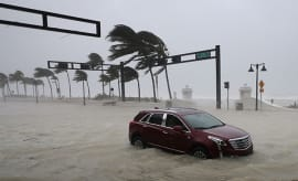 A car sits abandoned along North Fort Lauderdale Beach Boulevard during Hurricane Irma