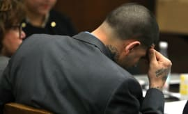 Aaron Hernandez listens to lawyers make arguments during his double murder trial.