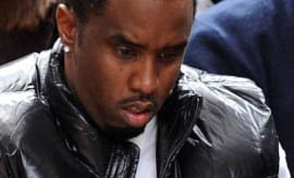Diddy is bewildered at the sight of a $1 bill.