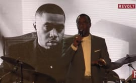 This is Puff Daddy giving Nas his Jimmy Iovine Icon Award.
