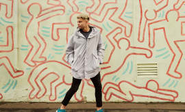 Jason Johannisen in front of Keith Haring mural