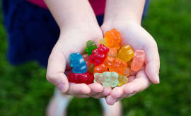 Child holding gummy bears