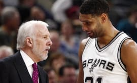 Tim Duncan and Gregg Popovich talk on the sidelines.