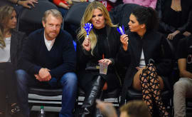 Gunnar Peterson, Khloe Kardashian and Kendall Jenner attend a basketball game