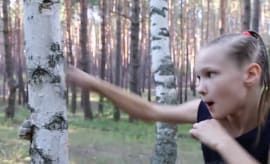 Evnika Sadvakasova destroying a tree