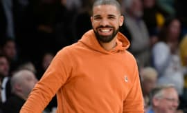 Drake smiles at a Lakers game.