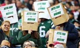 Jets fans with bags on their heads.