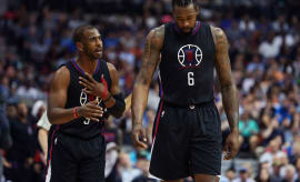 Chris Paul and DeAndre Jordan exchange words on the floor.