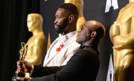 'Moonlight' director Barry Jenkins (R) and writer Tarell Alvin McCraney pose with the Oscar