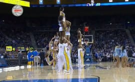 UCLA cheerleader takes a hard fall.