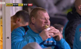 Backup goalkeeper Wayne Shaw eats a pie mid-game.