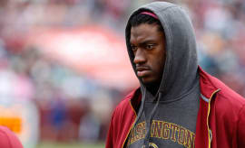 Robert Griffin III stands near the bench against the Philadelphia Eagles at FedEx Field.