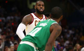 LeBron James looks at Kyrie Irving.