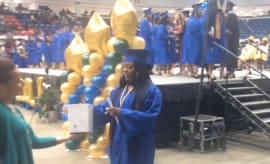 Flint graduates receive Beats by Dre headphones.