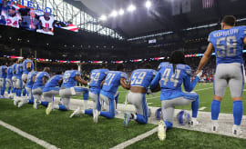 This is a photo of football players kneeling.
