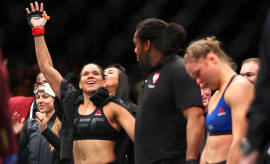 Amanda Nunes celebrates her victory over Ronda Rousey at UFC 207.