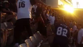 Rams and Cowboys fans fight during a preseason game.