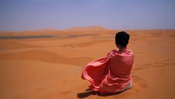 Woman meditating in the desert