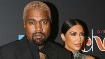 Kanye West and Kim Kardashian West pose