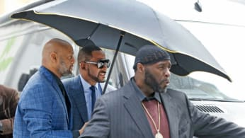 Singer R. Kelly arrives at the Daley Center for his hearing on child support