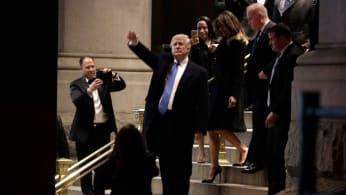 Donald Trump and Lady Melania Trump leave after dinner at Trump International Hotel o