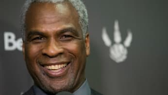 Charles Oakley laughs during a press conference.
