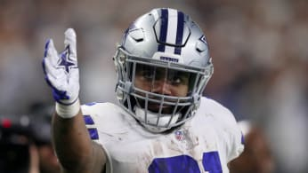 Ezekiel Elliott #21 of the Dallas Cowboys gestures for a first down
