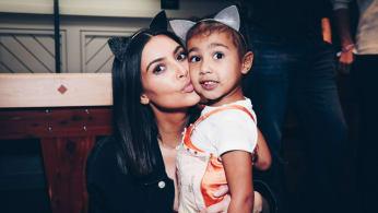 Kim Kardashian and North West attend Ariana Grande concert