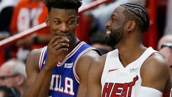 Dwyane Wade #3 of the Miami Heat talks with Jimmy Butler