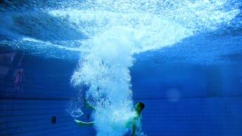 Man in pool.