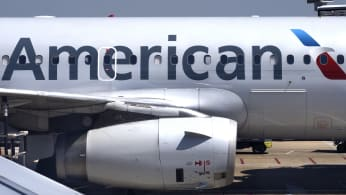 American Airlines passenger aircraft parked at gate at Ronald Reagan Washington National Airport.