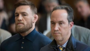 Conor McGregor (L) stands with his lawyer Jim Walden.