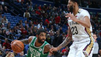Kyrie Irving #11 of the Boston Celtics handles the ball against Anthony Davis