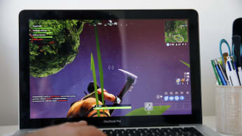 A gamer plays the video game 'Fortnite: Battle Royale'