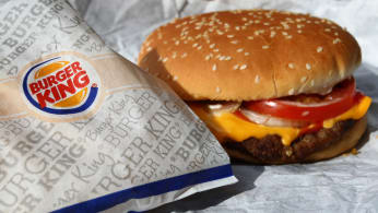 Whopper from the fast food chain Burger King sits on a packaging paper in Kaufbeuren,Germany.