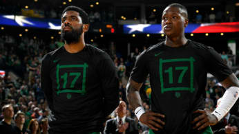 Kyrie Irving #11 and Terry Rozier #12 of the Boston Celtics