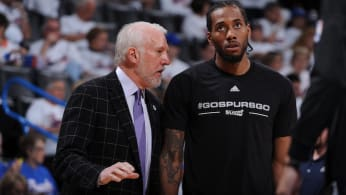 Gregg Popovich coaches Kawhi Leonard #2 of the San Antonio Spurs.