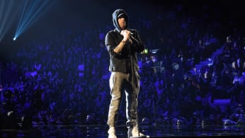 Eminem performs on stage during the MTV EMAs.