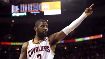 Kyrie Irving leads his team on the court.