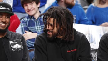 J. Cole watches the game between the Detroit Pistons and Dallas Mavericks.