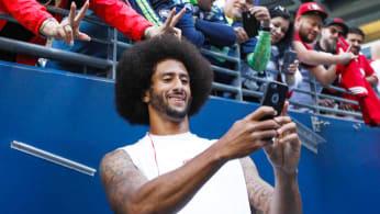 Colin Kaepernick takes a selfie with a 49ers fan.