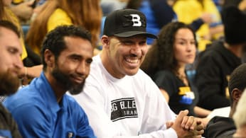 LaVar Ball looks on during a college basketball game