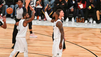 LeBron James #23 and Kyrie Irving #11 of Team LeBron give each other high fives