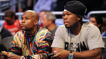 Floyd Mayweather and Rapper 50 Cent sit courtside during 2012 All-Star Weekend.